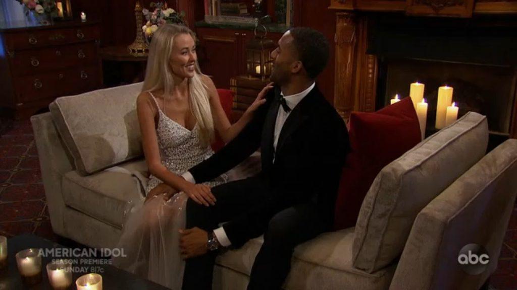 "Heather Martin in a white dress sitting with season 25 of ""The Bachelor"" bachelor Matt James"