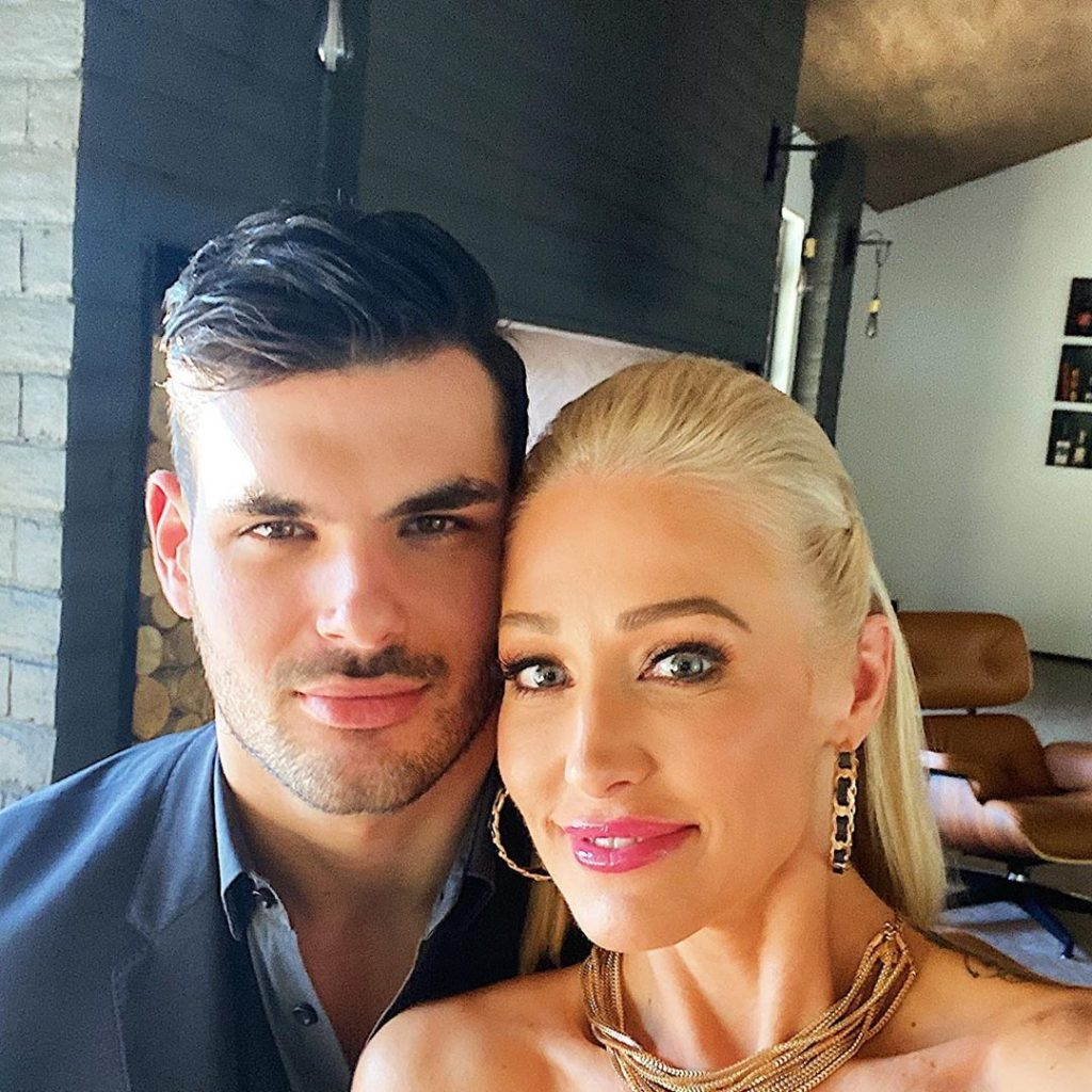Mary Fitzgerald and Romain from Selling Sunset pose together for a selfie.
