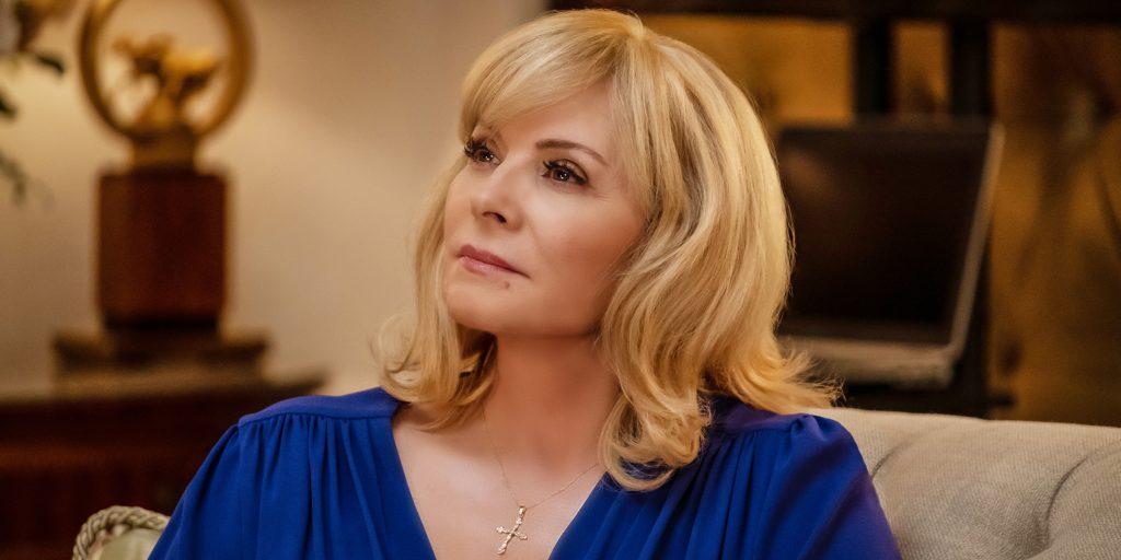 Kim Cattrall wearing a blue dress