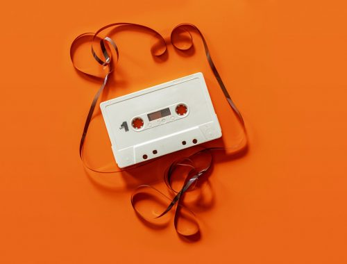 orange background with white cassette tape