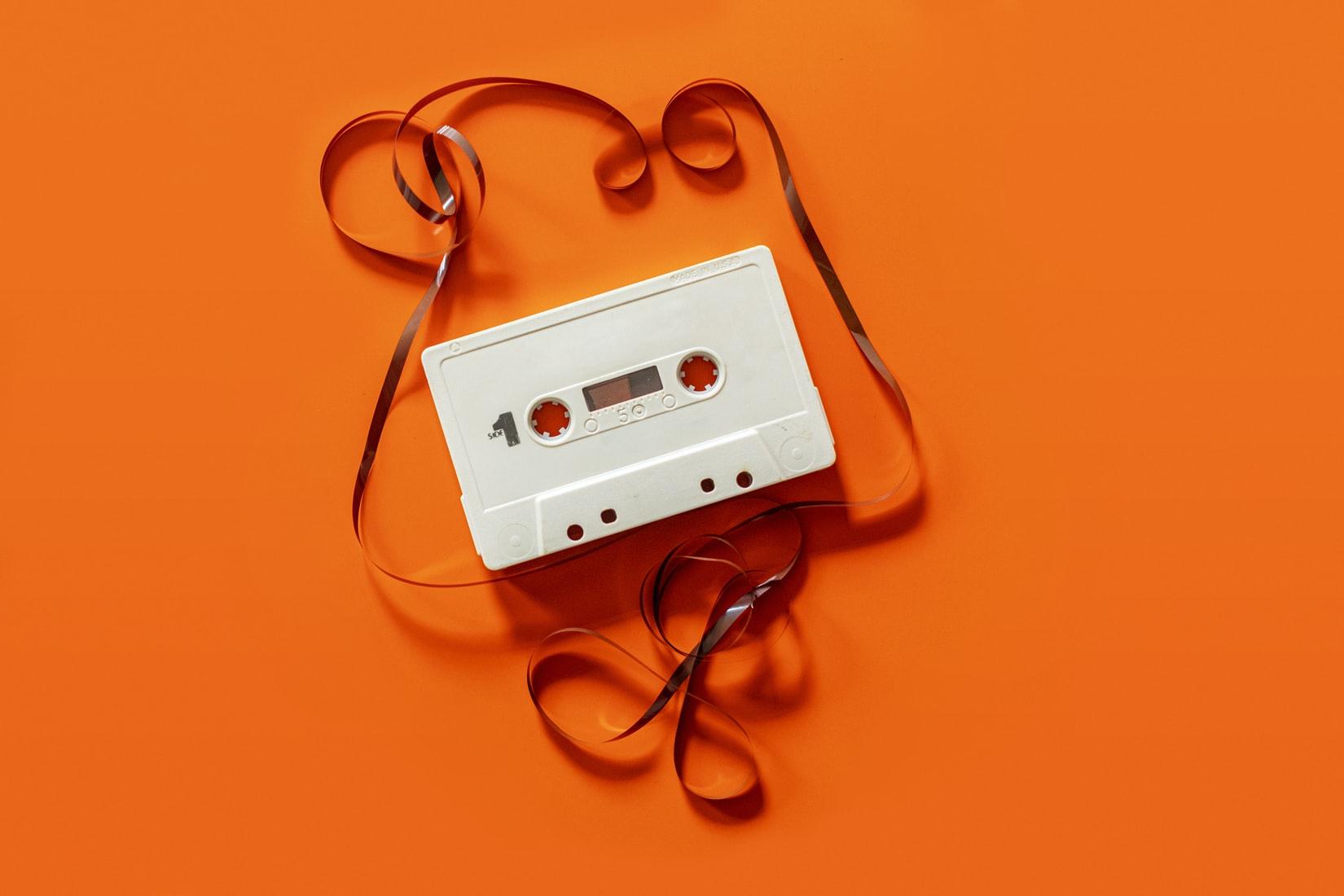 orange background with white cassette tape