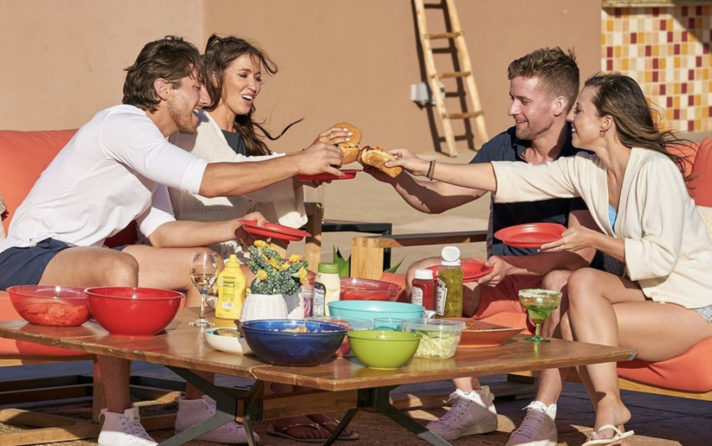 Katie Thurston, Connor, Kaitlyn and Jason toasting glasses